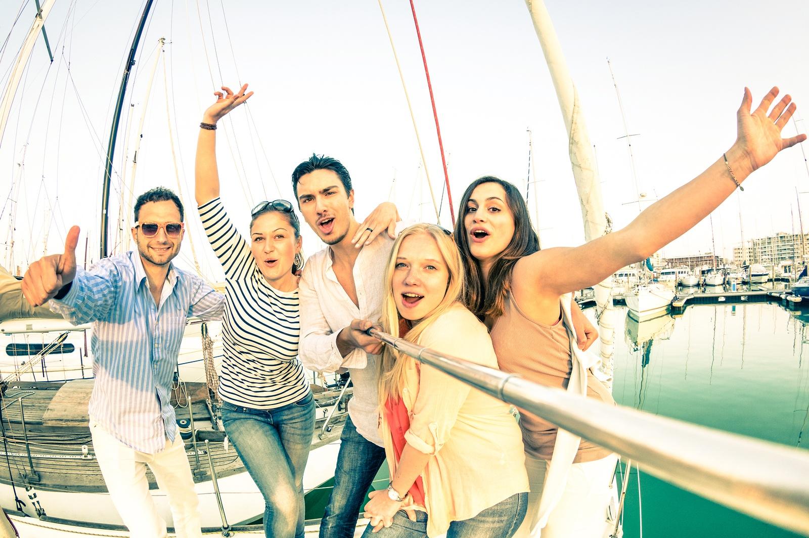bigstock-Best-Friends-Using-Selfie-Stic-93238793.jpg