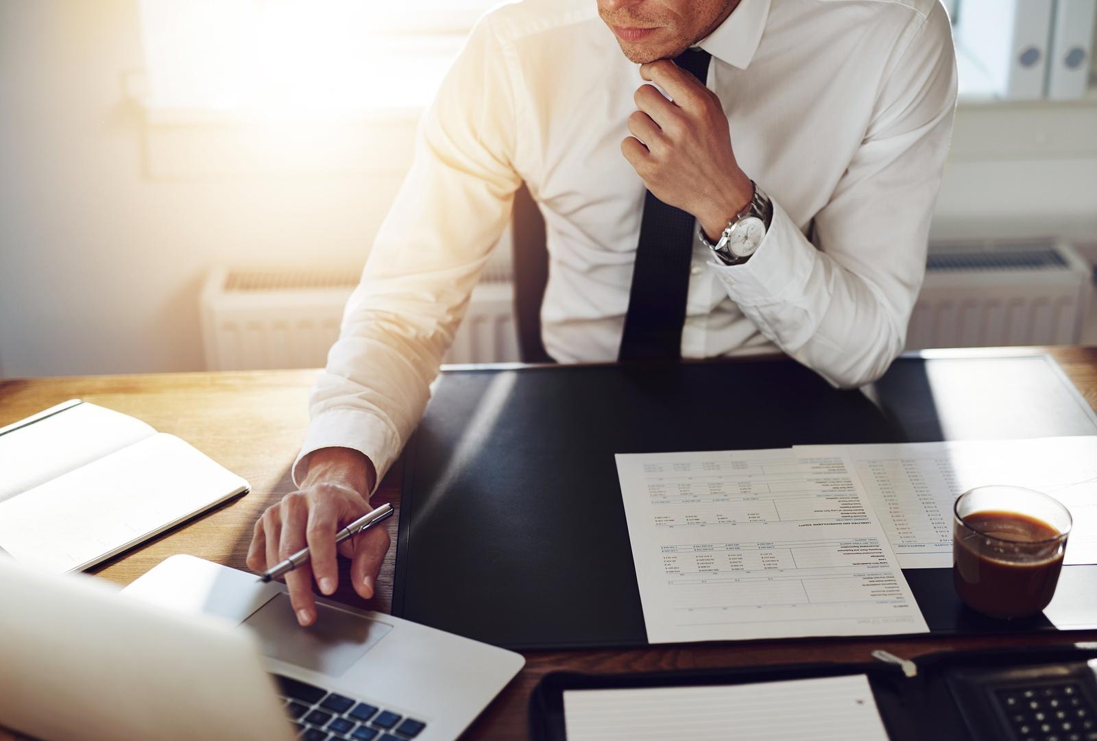 bigstock-Business-Man-Working-At-Office-106691141.jpg